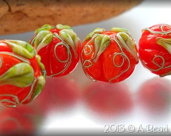 A Bead is Born handmade lampwork orange glass pumpkin bead harvest Halloween green leaves