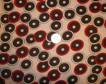 Polka dots on white poly rayon lycra knit blend 1 YD