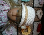 Beautiful cloche hat in with flower trim in cream cotton yarn to fit a Sasha Morgenthaler doll