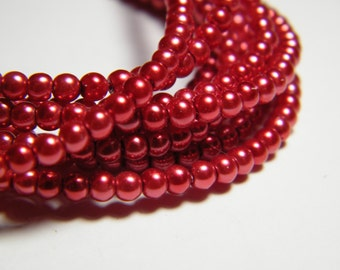 3mm round red glass pearls, strand aprox. 26 inches