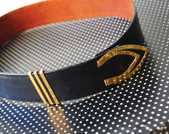 Nautical style vintage 70s charcoal black genuine leather belt with brown -rust genuine leather lining. Made by Beltmart. Size 28.