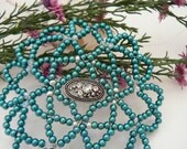 women beadead kippah in shades of teal pearls, silver and crystals.
