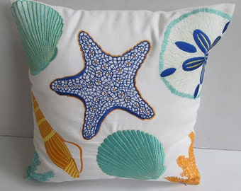 Sea themed pillow cover in  white  with aqua blue, orange and cobalt blue sea life embroidery 18 inch .