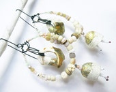A Precious Day. Rustic Gypsy Victorian Tribal white assemblage earring with beach shells, silkworm cocoons and gold leaf.