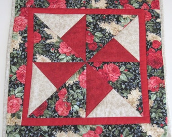 Quilted table topper,candle mat,  Pinwheel  Red Carnations