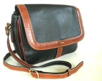 Vintage Bally purse. Sturdy dark navy blue / black pebble leather with brown trim. Pocket, compartments. Italy.