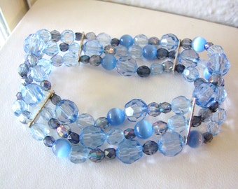 Pretty triple strand aqua blue beaded stretch bracelet with silver accents