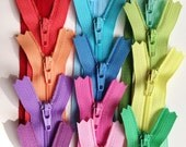 Fifteen 4 inch YKK zippers, light, pastel, muted - red, pink, coral, peach, yellow, blue, moss, mint, apple, lavender