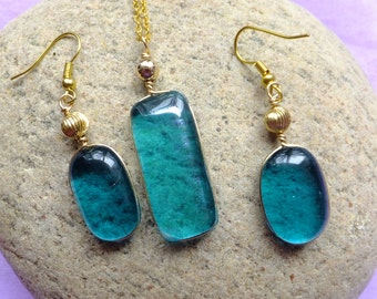 Necklace and earrings. Turquoise earring and necklace set with gold chain