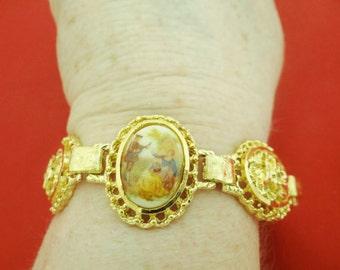 "Vintage 7"" gold tone bracelet with LIMOGES charm signed Fragonard in great condition, appears unworn"