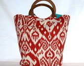 large red and white tribal print wooden handle bag with teal interior