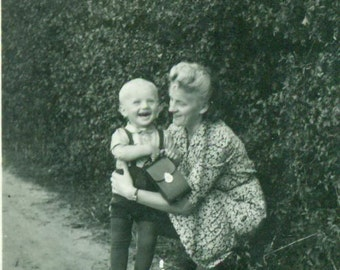 Happy Boy Holding Camera Case Held by Grandma 1930s Vintage Black White Photo Photograph