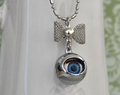 Halloween jewelry necklace EVIL DOLL EYE  silver color blinking blue eye charm with bow