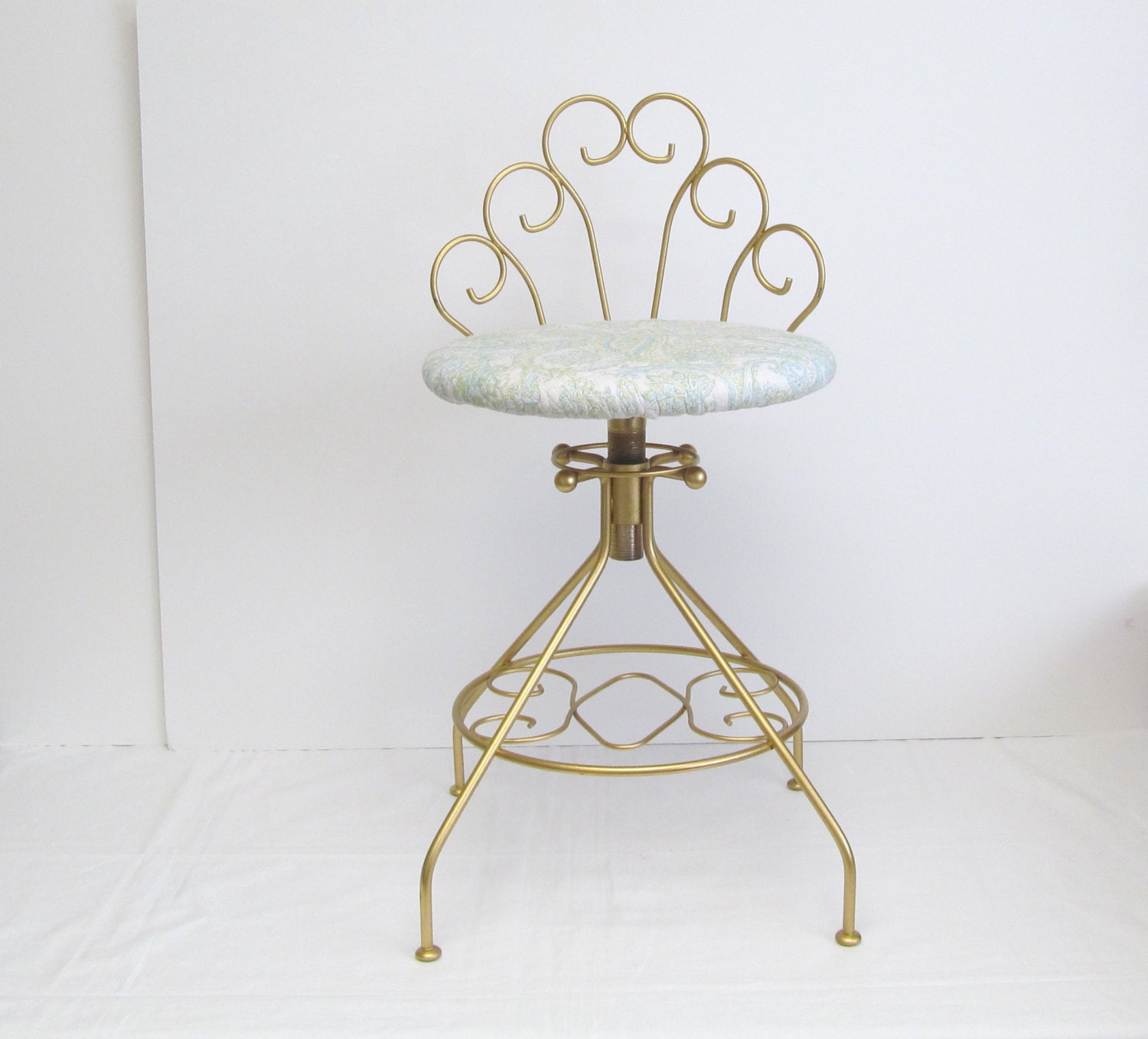 vintage modern vanity stool gold color with quilted aqua
