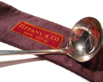 Vintage Tiffany and Company Sterling Silver Cream Ladle and Felt Bag Circa 1920.
