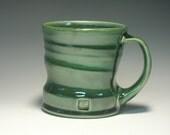 Green mug reserved for Hector Gutierrez