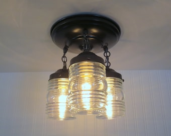 Dexter Trail. Clear Globe CEILING LIGHT Trio with Industrial flavor