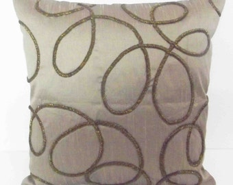"abstract spiral design on taupe cushion with copper wire zardozi handwork in size 16""x16"""