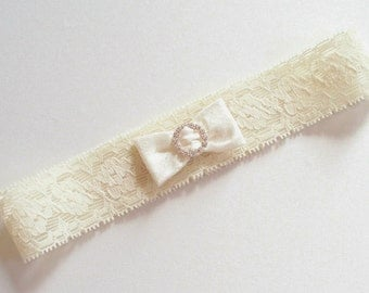 Ivory Garter in Narrow Stretch Lace with Mini Dupioni Silk Bow Gathered by a Tiny Circle of Rhinestones - The La Petite EMMA Garter