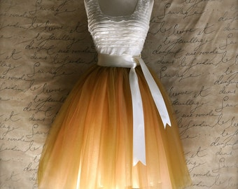 Women's tulle skirt in antique gold over peach lined in ivory satin with satin sash waist.