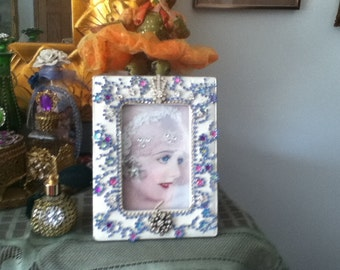 Jeweled picture frame with blue jewels