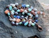 copper beach bracelet / navy blue teal seashells / pearls / sodalite / lapis / amazonite / peach shells / royal strength gemstones