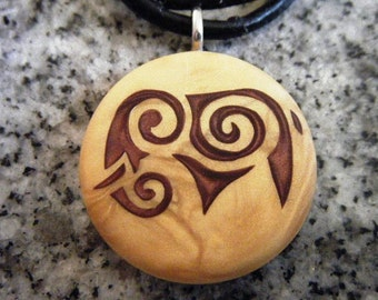 Tribal Elephant hand carved on a polymer clay light gold pearl color background. Pendant comes with a FREE 3mm necklace