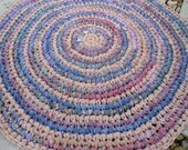 HALF OFF SALE 30 in Up-Cycled Crochet  fabric rug in light peach, blue, purple, lavender, taupe, green