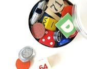 20 Vintage Game Pieces in Round Tin