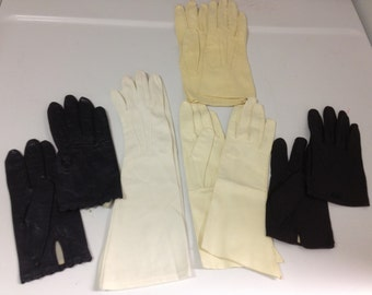 Vintage 5 Pairs of Black, Tan and Carmel Leather Gloves with Detailed Stitching, and Off White Fabric Gloves