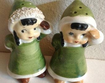 Cute Pair of Eskimo Girls Pepper Shakers