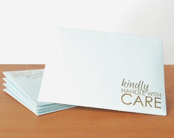 ice blue envelopes set of five: kindly handle with care