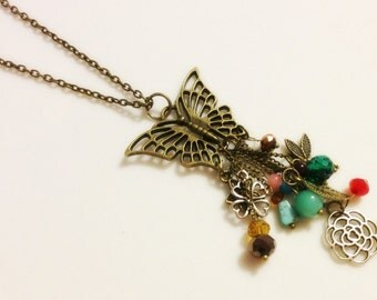 "SALE 20% off - Necklace - Antique Brass Butterfly Pendant - Glass Beads - Mixed Charms ""Spread Your Wings and Fly"""