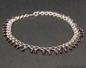 Sterling silver chainmaille garnet choker. Gemstone silver jewellery.