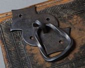 Vintage metal escutcheon plate with drawer pull handle.