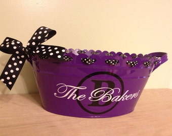 Personalized halloween scalloped oval metal bucket, tub, purple with family name for passing out candy