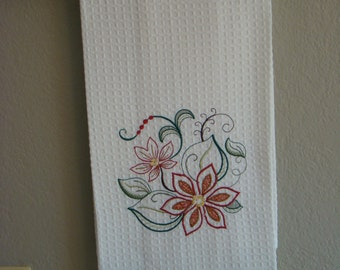 Cotton waffle weave towel with Christmas motif.