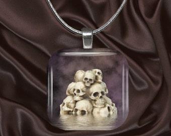 Mound of skulls glass tile pendant