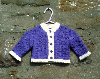 "Hand knitted baby girls purple and cream trim cardigan and hat set. 16"" chest"