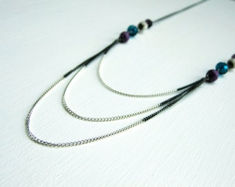 Black plated and silver chain loop necklace, book page and glass beads, turquoise and purple