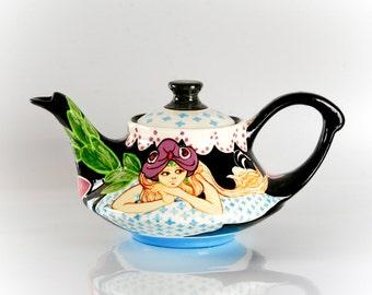 Decorative ceramic tea pot with genie motif