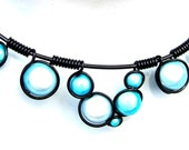 Wire wrapped necklace with pastel turquoise miracle beads, black wire and adjustable chain.