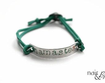Namaste ID Bracelet - Hand stamped, Om symbol, aluminum, green, faux suede, alloy buckle