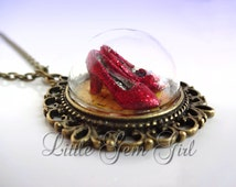 Wizard of Oz Necklace - Ruby Red Slippers Necklace - Wizard of Oz Jewelry Ruby Slippers on the Yellow Brick Road Glass Dome Brass Necklace