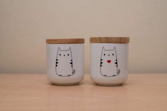 White ceramic canister with wooden lid and cute cat design