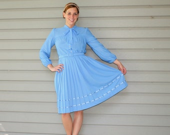 1970s baby blue belted day dress with ascot bow. Size medium 8-10