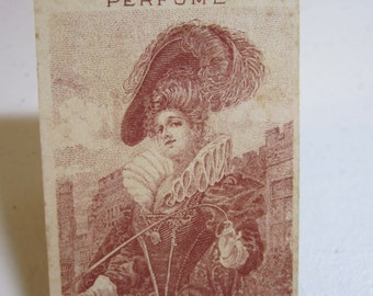 1909-1910 Dorothy Vernon perfume card calendar with image of a renaissance era lady in elaborate clothing hat