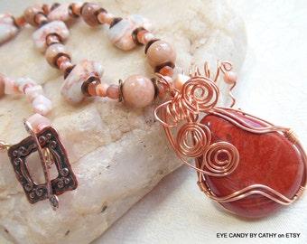 Orange coral pendant necklace