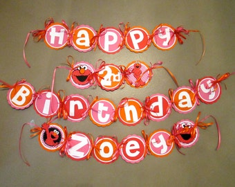 Elmo Birthday Banner in pink, orange and red with polka dots includes age