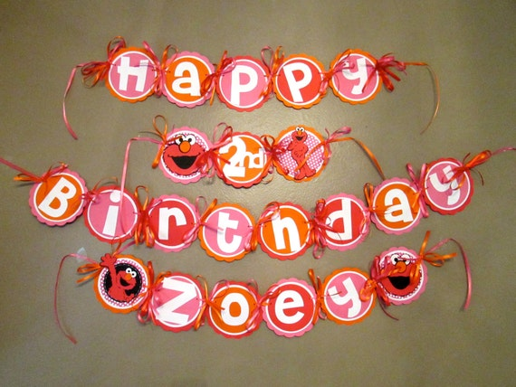 elmo birthday banner in pink orange and red with polka dots
